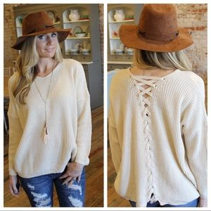 Cream lace up back cable knit sweater